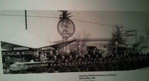 Long Island Railroad Executives in a miniature railroad. By 1964 railroads were not awe inspiring.