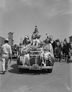 Left to right: Juanita Daugomah Ahtone (Kiowa), Evalou Ware Russell (center), Kiowa Tribal Princess, and Augustine Campbell Barsh (Kiowa) in the American Indian Exposition parade. Anadarko, Oklahoma, 1941.
